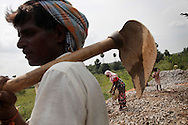 Villagers work at road construction site under National Rural Employment Guarantee Act (NREGA), a government program which guarantees every poor Indian 100 days of work at minimum wage, in Allipur village in Medak District in Andhra Pradesh, India on Oct 24, 2010. <br /> (Photo by Kuni Takahashi)