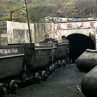 Lan Ba Coal Mine on the Laoying mountain in South West China is an illegal coal mine. They are able to operate because of the complicity with a local sheriff.  Illegal coal mines are often situated in the inner parts of mountains and very small.  If accidents occur they are simply shut and covered as if they never existed.. In coal miners run illegaly accidents occur  frequently because health and safety measures are ignored.  Just the bare fact that these mines are run on just one point of entrance and exit makes them extremely dangerous because if an accident occurs close to the shaft there is no passage to escape from.