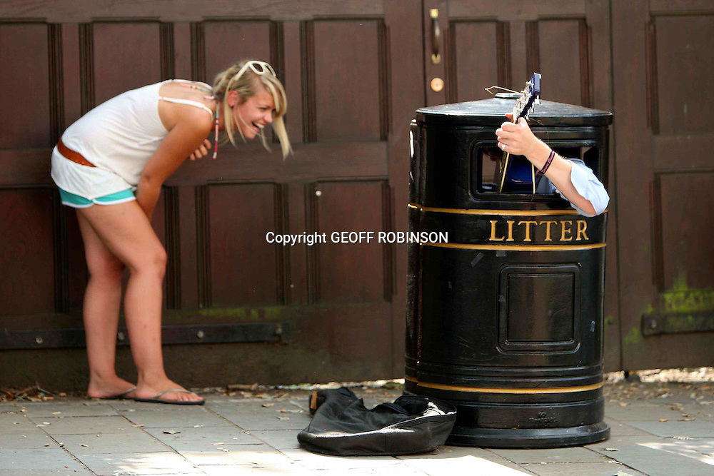 A man who sings in a BIN has helped to persuade a city council that busking is not RUBBISH. ..Busking bin man Charles Cavey, 29, plays his guitar whilst squeezed into a tiny metal rubbish bin...At 5ft 9 he finds his job cramped and smelly but his unique singing style has proved a huge hit with passers-by...Councillors in the historic university city of Cambridge had planned to clamp down on this type of street entertainment, but a recent survey has shown that busking is in fact hugely popular with residents and tourists...Now Cambridge is holding its first busking festival to celebrate street performing and Charles is among 40 acts taking part...ìI saw a man empty a rubbish bin one day and thought I could fit inside it, then I learnt to play the guitar and a friend reminded me what I had said so I gave it a go,î said Charles...ìPeople wonder what's going on when they see me, then they start getting their cameras out.î..The three-day festival, which starts today (TUES) includes bands, belly dancers, an escapologist and a magician...They will be busking in 24 locations throughout the city centre and if it is successful the council hopes it will become an annual event...Heather Bevan-Hunt, festival organiser, said: ìWe are a big city so we tend to get a lot of people busking...ìWe were thinking of introducing a badging system for buskers, but lots of people said they gave Cambridge a special ambiance and helped to make it a unique place...ìNow instead we've decided to hold a festival to celebrate this.î.Charles added: ìI think the festival is a great idea. There are always lots of people looking for something to make them smile.î..