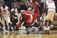 "comes up with the ball in front of Ole Miss' Nick Williams (20) at the C.M. ""Tad"" Smith Coliseum in Oxford, Miss. on Saturday, December 1, 2012. (AP Photo/Oxford Eagle, Bruce Newman).."
