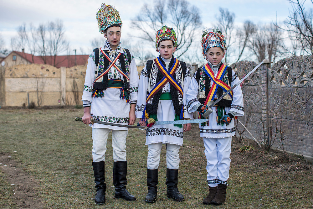 KRASNOILSK, UKRAINE - JANUARY 14: Villagers celebrating the winter festival of Malanka pose for a portrait on January 14, 2015 in Krasnoilsk, Ukraine. The holiday, which involves dressing in elaborate costumes and going from house to house as a group singing traditional songs, is celebrated on New Year's Day of the Orthodox calendar, a week after Orthodox Christmas.