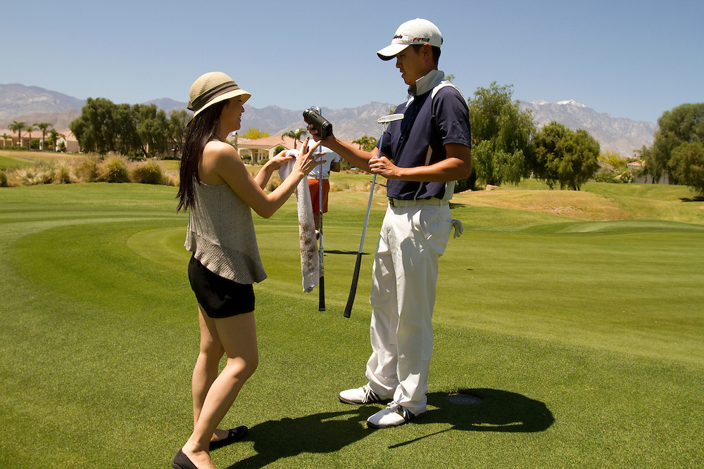 Daniel Im competes on the Golden State Golf Tour at the Sixon Series Westin Challenge tournament in Rancho Mirage, CA. The mini tour lacks all the frills of a major tour, so Daniel's girlfriend, Arden Cho, often is seen fetching clubs and towels for him during his round.