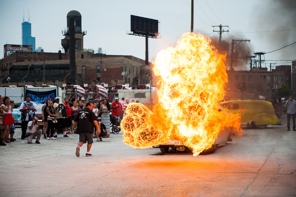 The Voodoo Kings Car Club Illinois perform a flame throwing demonstration at Slow & Low Community Lowrider Festival, Chapter 4.
