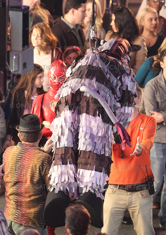 "January 26th 2012 Los Angeles, CA. Non Exclusive. Olivia Wilde in a superhero costume and Jim Carrey as a Zebra Piñata, film a funny street magic performance scene for the film ""The Incredible Burt Wonderstone"". Also in the scene was Steve Carell, Steve Buscemi & Alan Arkin. In the scene a volunteer picked from the crowd continually hits Jim Carrey with a baseball bat.The Magic gag is that Carrey suddenly disappears and the piñata breaks open and candy falls onto the amazed crowd. Filming took place at Universal Studios City Walk. Photo by Eric Ford / On Location News 1/818-613-3955 info@onlocationnews.com"