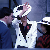 Princess of Wales Diana Spencer waves to well-wishers as she arrives at the Washington National Cathedral during her visit to Washington, DC in November 1985.