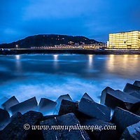 Night time view of the River Urumea and the Kursaal in San Sebastians Gros area.