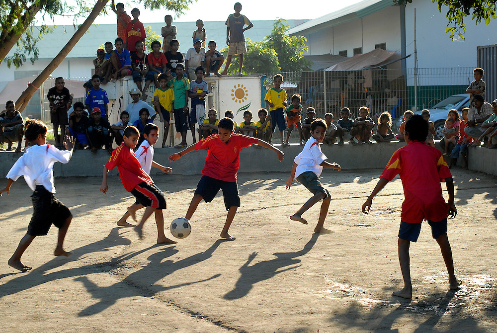Don Bosco World Cup 2006. A game of soccer between East Timorese boys wearing World Cup colours brings some happiness to the thousands of displaced people who are taking refuge at the Dom Bosco Roman Catholic College due to the escalation of gang violence that erupted in Dili. East Timor 10 June 2006