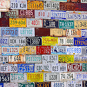 SHOT 5/18/08 1:17:05 PM - License plates from about every state imaginable on display on the side of a building in St. Elmo, Co. The town is a ghost town located in Chaffee County, Colorado, United States. Founded in 1880, St. Elmo lies in the heart of the Sawatch Range, 20 miles southwest of Buena Vista. To this day it is one of Colorado's most preserved ghost towns. Nearly 2000 people settled in this town when mining for gold and silver became evident. The mining industry started to decline in the early 1920s, and in 1922 the train discontinued service. There are currently 8 year-round residents in this area. .(Photo by Marc Piscotty / © 2008)