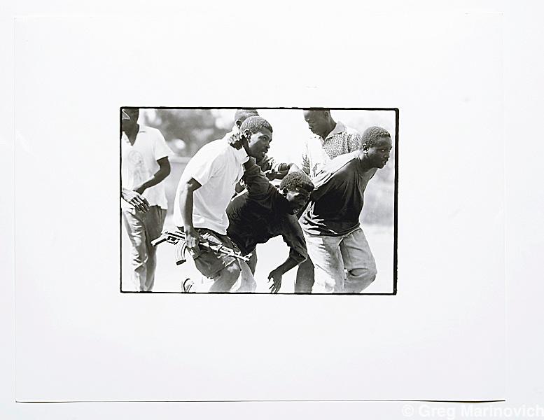 Copy of a vintage print by Joao Silva. Thokoza, south of Johannesburg.
