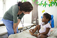 Project HOPE volunteer nurse Jill Caporiccio talks with a young cholera patient who is feeling much better at the Hospital Albert Schweitzer on Friday, October 29, 2010 in Deschapelles, Haiti.