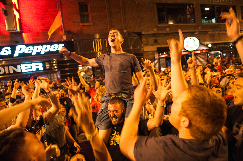 Chicago Blackhawks fans celebrate the 2013 Stanley Cup victory on Clark Street in Wrigleyville on June 24, 2013.