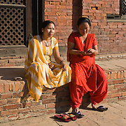 "Women in yellow and red saris, Patan, Nepal. Patan was probably founded by King Veer Deva in 299 AD from a much older settlement. Patan, officially called Lalitpur, the oldest city in the Kathmandu Valley, is separated from Kathmandu and Bhaktapur by rivers. Patan (population 190,000 in 2006) is the fourth largest city of Nepal, after Kathmandu, Biratnagar and Pokhara. The Newar people, the earliest known natives of the Kathmandu Valley, call Patan by the name ""Yala""  (from King Yalamber) in their Nepal Bhasa language. UNESCO honored Patan's Durbar Square (Palace Square) as one of the seven monument zones of Kathmandu Valley on their World Heritage List in 1979. All sites are protected under Nepal's Monuments Preservation Act of 1956."