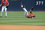 Mississippi's Tanner Mathis (12) makes a catch vs. St. John'svs. St. John's during an NCAA Regional game at Davenport Field in Charlottesville, Va. on Sunday, June 6, 2010.