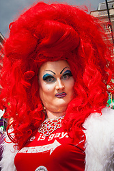 London, June 28th 2014. A drag queen poses for the camera as the Pride London parade proceeds through the city's streets.