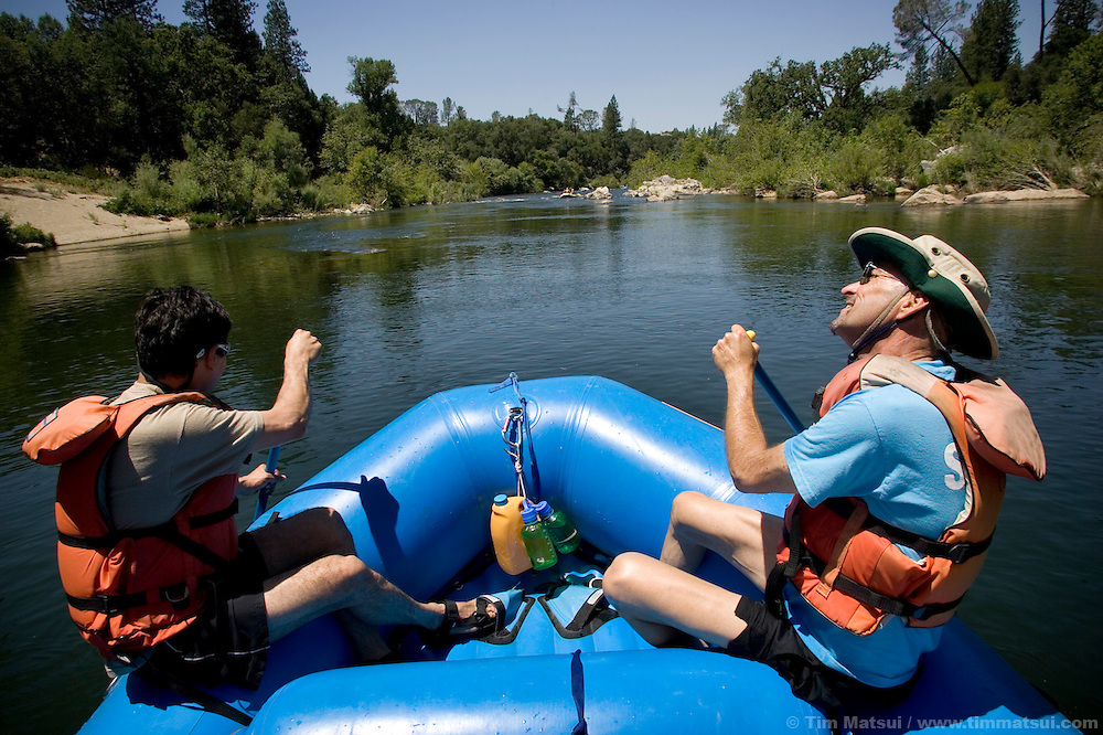 """SATURDAY JULY 8, 2006 - LOTUS, CA  The ever comedic Joseph Chase, right, sings """"Old Man River"""" while rafting with Ruben Garcia, left, at the Healing Waters weekend retreat, a non profit whose mission is to empower, inspire and enrich the lives of people challenging HIV/AIDS through wilderness adventures, on Saturday, July 8, 2006 on the South Fork of the American River in Calif."""