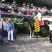 Jockey Jose Ortiz and Belle Gallantey and owner pose for photos in the winner circle after the running of the 77th running of The Delaware Handicap Saturday, July 12, 2014, at Delaware Park Race Track in Newark, DEL.  <br /> <br /> The Delaware Handicap is for Fillies and Mares three years old and upward and the winner is rewarded $750.000