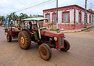 Tractor hauling a pig in San Antonio de los Banos, Artemisa, Cuba.