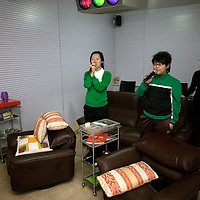 BEIJING, 25. JANUARY, 2009 :   Mr. Li's  relatives sing karaoke in the basement of his apartment on new years' eve  in Beijing .<br /> Mr. Li, a paper factory owner, is facing one of his most difficult times .&quot; Last November the market suddenly went down ,&quot; Li says.   <br /> He had bought paper, a lot of paper, and paid 7000 Yuan/ t .<br />  Li's company buys paper from paper mills and lives from the sales to publishing houses and other companies.  Since the market's collapse , he manages to sell the paper only for 6000 Yuan/t.<br /> His clients' export business to the USA had shrunk in Southern China. Mobile phone manufacturers don't need paper for the instruction guides to their mobile phones anymore as their US clients buys less China- made mobile phones.<br />  Toy manufacturers don't need paper anymore  because Americans import less toys from China. &quot; The crisis has driven many of my clients into bancruptsy&quot;, says Li.<br />  <br /> China's Communist Party  which will celebrate its 60th anniversary in October, currently faces its biggest challenge since the beginning of the economic reforms 30 years ago  : &quot; The phase of  rapid economic growth is over. For the first time the government is threatened with a  mistrust of a wide section of the population&quot;, warns the Communist party's Shang Dewen in Beijing.   <br /> Not only the China's poorest worry about the furture, but as well China's middle class is concerned about the crisis.     1,5 Millionen university graduates didn't find a job until the end of 2008  and this summer there'll be an additional  6,1 Million new graduates. More than 12 percent of university graduates face unemployment in 2009.
