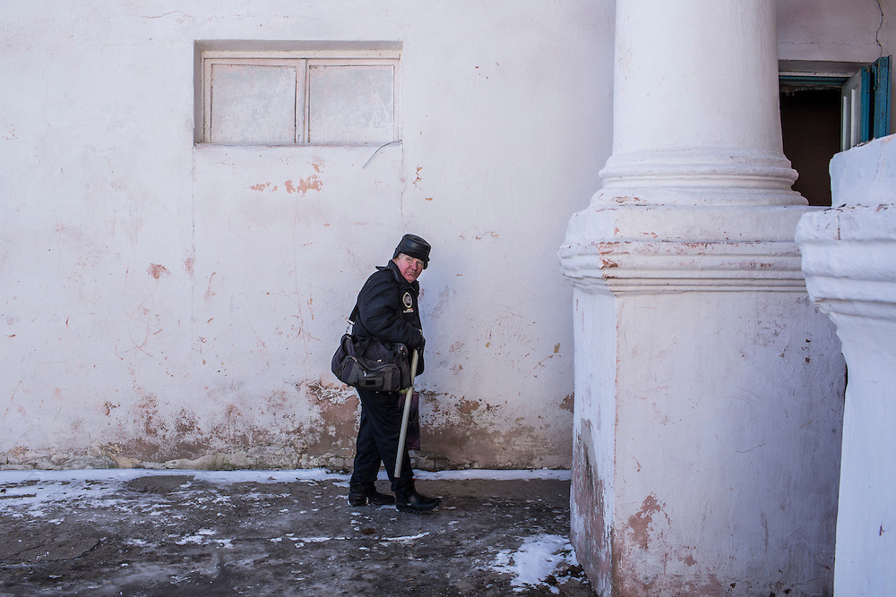 MYRONIVSKYI, UKRAINE - FEBRUARY 17: A man outside the local House of Culture, which serves as a distribution point for humanitarian aid and provides a bomb shelter, on February 17, 2015 in Myronivskyi, Ukraine. A ceasefire agreed to by Ukraine and pro-Russian rebel forces has failed to prevent fighting in the nearby town of Debaltseve, where thousands of Ukrainian troops remain and whom rebels claim to have surrounded. (Photo by Brendan Hoffman/Getty Images) *** Local Caption ***