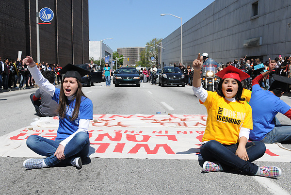 Atlanta, GA-April 5, 2011: More than 100 protesters led by seven young people brought to the United States as young children -- and who were later arrested after blocking traffic in protest -- marched through downtown Atlanta to raise awareness about undocumented youths.<br /> <br /> After a rally in Hurt Park near Georgia State University, protesters delivered a letter to the school's admissions office which asked GSU officials not to comply with a ban on undocumented immigrants that takes effect this fall. <br /> <br /> The Georgia Board of Regents in October voted to prohibit undocumented students from attending five of the state's most selective colleges...After delivering the letter to surprised admissions officials, the hundreds-strong crowd marched and chanted &quot;Education, not deportation,&quot; &quot;Undocumented and unafraid&quot; and &quot;Education, not segregation.&quot;.<br /> <br /> The seven undocumented youths then unfurled banners and sat in the middle of Courtland Street, blocking traffic for close to an hour before they were all arrested. Late Tuesday evening, U.S. Customs and Immigration enforcement officials were reportedly determining whether the arrested students would face deportation.<br /> <br /> &quot;I am doing this for my family, for my brothers and sisters,&quot; said Dayanna Rebolledo, a 21-year-old factory worker and student who came to the United States from Mexico when she was 9 years old. &quot;We are undocumented and unafraid. We are standing up for those undocumented who are afraid and who are in the shadows. We are risking everything to give our community a chance.&quot;