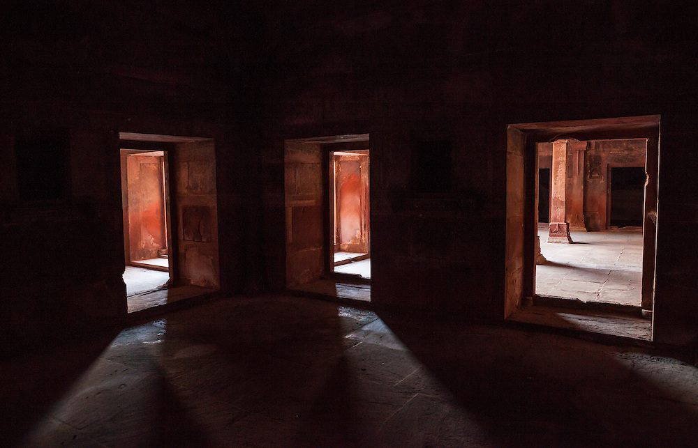Three doorways in a dark room, Fatehpur Sikri, Uttar Pradesh, India.