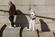 A couple walk up the shallow steps out of the Guggenheim museum in Bilbao