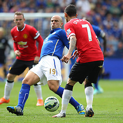 Manchester United's Angel Di Maria nutmegs Leicester City's Esteban Cambiasso during the Barclays Premiership match between Leicester City FC and Manchester United FC, at the King Power Stadium, Leicester, 21st September 2014 © Phil Duncan | SportPix.org.uk