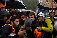 Brazilian surfer Carlos Burle (2R) and Havaiian Garrett Mcnamara (R) watch on the LCD of a camera pictures of the day's surfing.  Carlos Burle surfs the tallest wave of the day at North Beach during a giant swell that hit the Portuguese coast today at Nazare, Center of Portugal, 28 October 2013. Havaiian Garrett Mcnamara's set the record for the biggest wave ever surfed on January 2013 also at Nazaré. PAULO CUNHA /4SEE