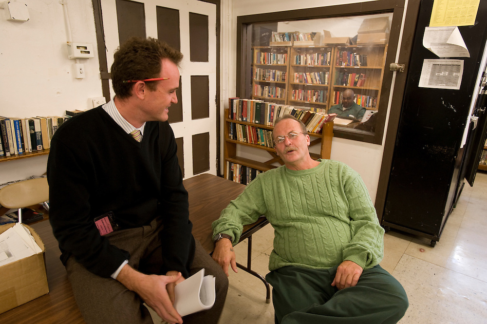 "Max Kenner (left) with inmate and Bard College graduate Bill Doane (55) in the computer room at Woodbourne Correctional Facility. Max is the brainchild behind the privately funded Bard College  Initiative for prison inmates. Bill, who graduated from Bard in 2008, was sentenced to 24 years in prison..In the back room: Inmate Stacey C. Williams studies in the library...Story: The Bard Prison Initiative.Former inmate Carlos Rosario, 35-year-old husband and father of four, was released from Woodbourne Correctional Facility after serving more than 12 years for armed robbery. Rosado is one of the students participating in the Bard Prison Initiative, a privately-funded program that offers inmates at five New York State prisons the opportunity to work toward a college degree from Bard College. The program, which is the brainchild of alumnus Max Kenner, is competitive, accepting only 15 new students at each facility every other year. .Carlos Rosario received the Bachelor of Arts degree in social studies from the prestigious College Saturday, just a few days after his release. He had been working on it for the last six years. His senior thesis was titled ""The Diet of Punishment: Prison Food and Penal Practice in the Post-Rehabilitative Era,"".Rosado is credited with developing a garden in one of the few green spaces inside the otherwise cement-heavy prison. In the two years since the garden's foundation, it has provided some of the only access the prison's 800 inmates have to fresh vegetables and fruit...Rosario now works for a recycling company in Poughkeepsie, N.Y...Photo © Stefan Falke"