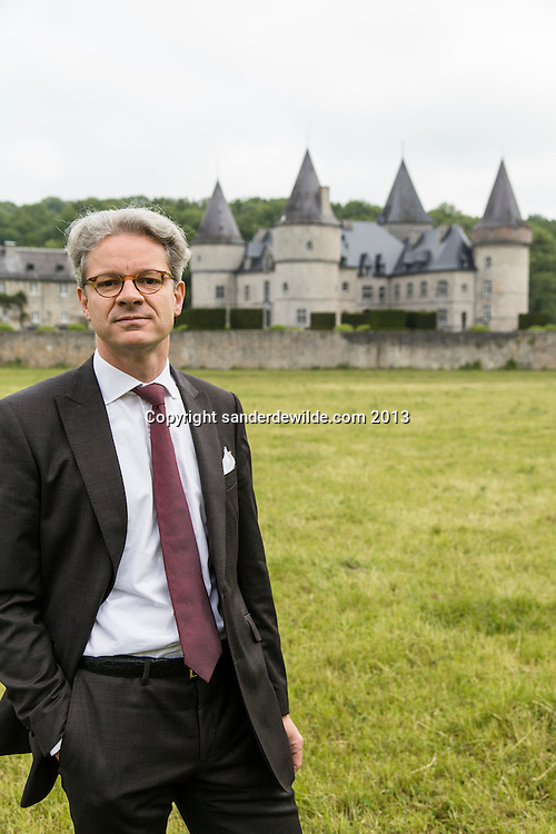 Interior architectThierry THENAERS looking at camera in front of the Chateau d'Anthée, part of which has been renovated and decorated by him in Anthée, Belgium on the 10th of June 2013, Anthée, Belgium. Credit Sander de Wilde for The Wall Street Journal.  Castle
