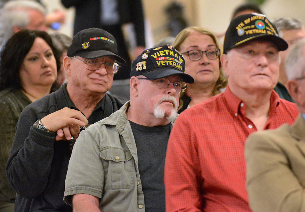 jt031817a/a  sec/jim thompson/ from back to front Vietnam Vets Charles McCorvy, Tom Buckley and Gilbert Flores listen as other vets were not all that happy with their treatment or the lack there of from the VA at the town Hall meeting by Congresswomen Michelle Lujan Grisham at the Expo New Mexico Saturday morning. Saturday March 18, 2017. (Jim Thompson/Albuquerque Journal)