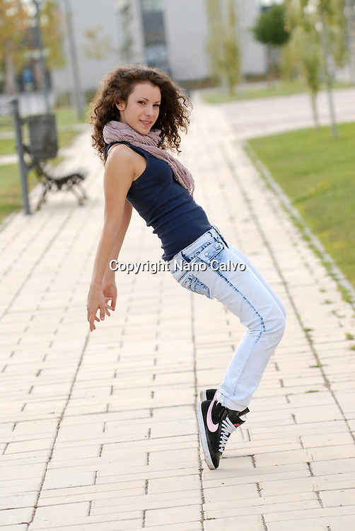 Cute teen dancer doing a street dance movement