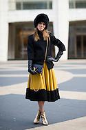 Yellow Skirt and Black Fur Hat, Outside Ruffian