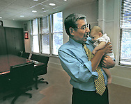 Mayor Joe Serna (cq) holds his grandson Andre Miguel Mayorga (cq), 2 mos., in his office, Thursday, June 24, 1999.  With his family at his side, Mayor Serna revealed that he has developed lung cancer and will not seek a third term in office.  He held his condition in tight confidence with his wife, Isabel, since the  diagnosis in late March, 1999 so as not to worry his daughter who was six months pregnant at the time.  Many of his closest friends and civic allies gathered in his office to hear his statement to the media.
