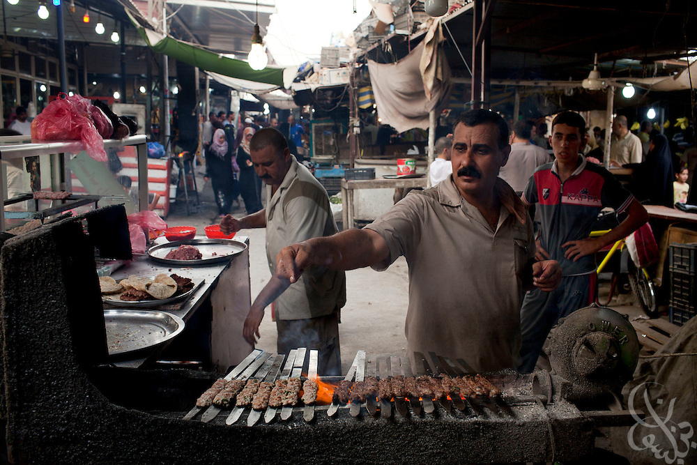 An Iraqi Kababchi prepares traditional Iraqi spiced kabab inside the thriving central market place in the Amil neighborhood in Southwest Baghdad August 23, 2010. Through an increase in Iraqi security force checkpoints and gated communities, Iraqis have enjoyed a vast improvement in terms of security over the past two years in areas like Amil, which previously had been sectarian battlefields with Iraqis forced to remain inside their homes for protection.   .