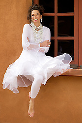 beautiful woman sitting on a window sill in Santa Fe, NM