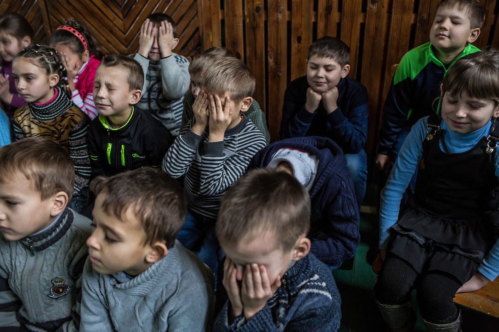 Students attend a landmine awareness training held by the Swiss Foundation on Mine Action at School #21 on Tuesday, December 15, 2015 in Scherbynivka, Ukraine.