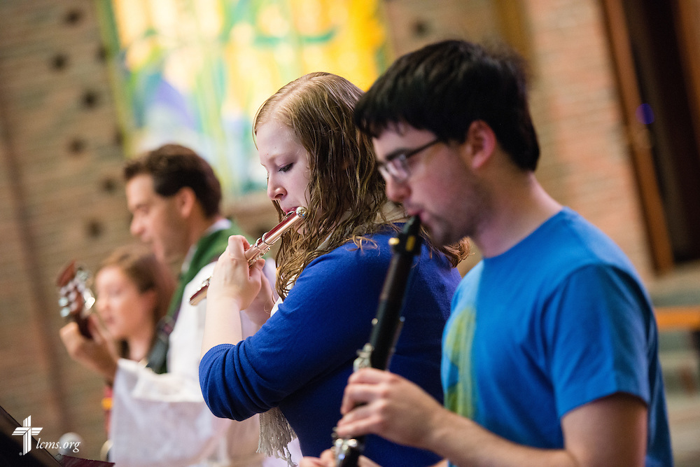 Rebecca Keehner on flute (center) and Matt Wahl on clarinet perform during chapel service in the Chapel of Our Lord on the campus of Concordia University Chicago in River Forest, Ill., on Friday, Oct. 10, 2014. Behind them are  the Rev. Dr. Jeffrey Leininger, Concordia University Chicago campus pastor and pre-seminary director, and vocalist Rebekah Thoelke. LCMS Communications/Erik M. Lunsford