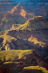 Dappled light on Isis Temple, Cheops Pyramid, and Palteau Point in the Grand Canyon.