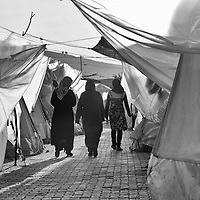 Syrian refugees walk inside a refugee camp in Reyhanli, Turkey, Saturday, March 17, 2012. The number of Syrian refugees in Turkey is now about 17,000. March 2012.