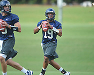 Quarterback Evan Ingram (19) goes through a drill as the University of Mississippi began football practice in Oxford, Miss. on Saturday, August 6, 2011. The team began practicing outside before lightning in the area sent them indoors for practice. (AP Photo/Oxford Eagle, Bruce Newman)