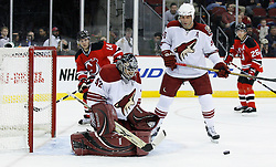Mar 12, 2009; Newark, NJ, USA; Phoenix Coyotes goalie Josh Tordjman (42) makes a save during the second period at the Prudential Center.