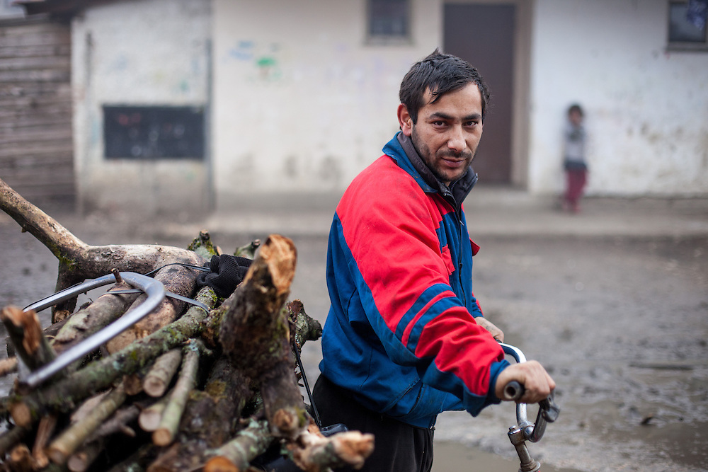 "Man after coming back from collecting wood on a bike for heating his house at the Roma settlement located in ""Budulovskej Street"" in Moldava nad Bodvou, Eastern Slovakia about 30 km from Kosice."