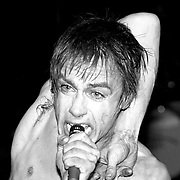 Iggy Pop performs onstage at the Palladium theater in New York City in October, 1977.