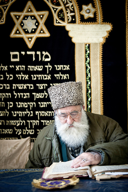 USE ARROWS &larr; &rarr; on your keyboard to navigate this slide-show<br /> <br /> Bukhara, Uzbekistan 23 March 2012<br /> Rabbi Araon Sianov reads the Torah in a synagogue of Bukhara.<br /> Bukharan Jews, also Bukharian Jews or Bukhari Jews are Jews from Central Asia who speak Bukhori, a dialect of the Tajik-Persian language.<br /> Their name comes from the former Central Asian Emirate of Bukhara, which once had a sizeable Jewish community. <br /> The great majority of Jews of Bukhara have emigrated to Israel or to the United States while others have emigrated to Europe or Australia.<br /> Photo: Ezequiel Scagnetti