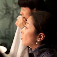 BEIJING, DECEMBER-15 :   Miss X ( name ?) , partner of  Sara Jane Ho 's etiquette company , listens to her friend speaking.  In 2013 the 27- year -old Harvard Business School graduate will start  Institute Sarita, a boutique finishing school offering courses in Mandarin for high prices . Ho plans  to teach affluent Chinese the ''importance of being finished'' . Ho learnt her skills at Institut Villa Pierrefeu, Switzerland's last traditional finishing school, where a six-week course covering skills including flower arranging, hostessing and table-setting costs around $20,000.