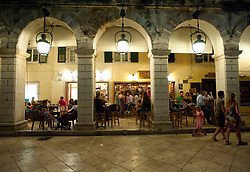 Night views of the cafes on The Liston street in central Kerkya Town on Corfu Island in Greece