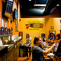 TAMPA, FL -- A packed tasting room at the Cigar City Brewing bustles with energy and beer in Tampa, Florida.  (Photo / Chip Litherland)