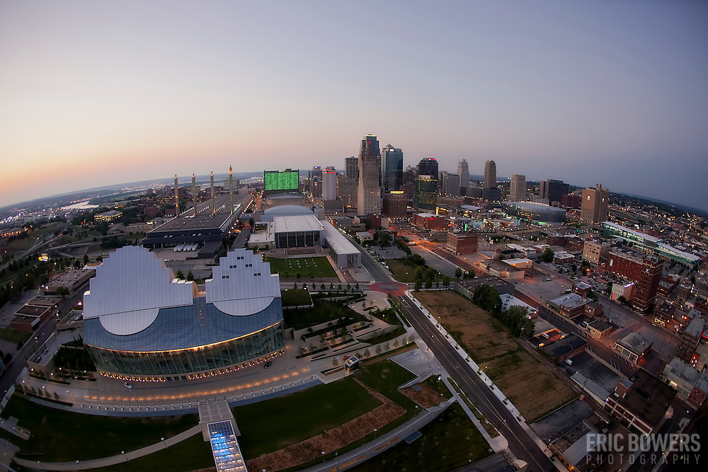 Fisheye lens aerial view of downtown Kansas City buildings and skyline. Kauffman Center for the Performing Arts in foreground.