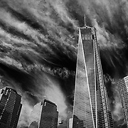 """SHOT 11/23/13 11:31:58 AM - One World Trade Center (also known as 1 World Trade Center, One WTC and 1 WTC; the current building was dubbed the """"Freedom Tower"""" during initial basework) refers to the main building of the new World Trade Center complex in Lower Manhattan, New York City. It is the tallest skyscraper in the Western Hemisphere and the fourth-tallest in the world. The top floor of One World Trade Center is 1,368 feet (417 m) above ground level, along with a 33 ft 4 in (10.16 m) parapet; this is identical to the roof height of the original One World Trade Center. The tower's antenna/spire brings it to a pinnacle height of 1,776 feet. One World Trade Center is principally owned by the Port Authority of New York and New Jersey. Around 5 percent equity of the building was sold to the Durst Organization, a private real estate company, in exchange for an investment of at least $100 million. (Photo by Marc Piscotty / © 2015)"""
